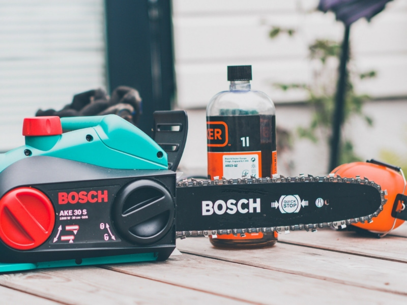 black-and-teal-Bosch-chainsaw