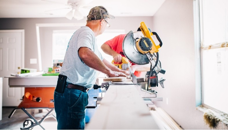 man in front of miter saw