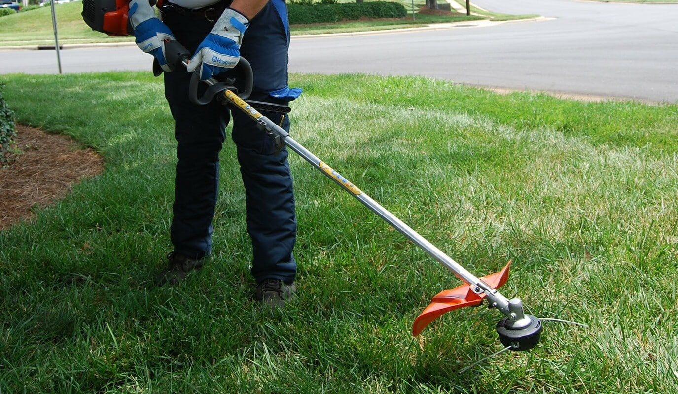 how to hold string trimmer